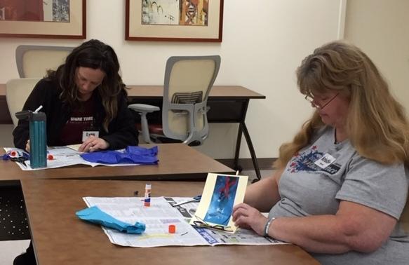 working on their journals at Women Veterans Creative Retreat Nov 2018